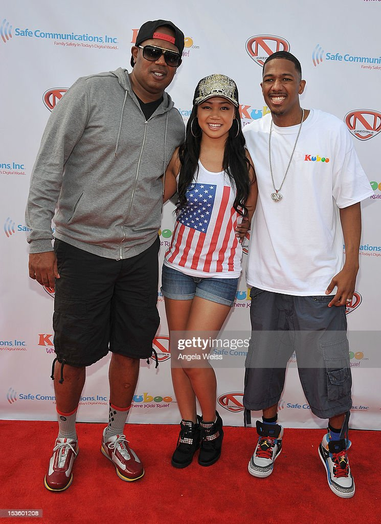 Rapper and actor <a gi-track='captionPersonalityLinkClicked' href=/galleries/search?phrase=Master+P&family=editorial&specificpeople=236055 ng-click='$event.stopPropagation()'>Master P</a>, actress Cymphonique Miller and actor Nick Cannon arrive at 'Family Day' hosted by Nick Cannon at Santa Monica Pier on October 6, 2012 in Santa Monica, California.