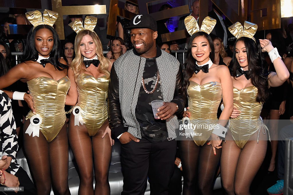 Rapper and entrepreneur 50 Cent (C) arrives at the The Playboy Party during Super Bowl Weekend with Playboy Playmates Eugena Washington, Carly Lauren, Hiromi Oshima and Ashley Doris wearing Bunny costumes inspired by the gold detailing on his limited edition EFFEN Vodka football bottle. The Playboy Party celebrated the future of Playboy and its newly redesigned magazine in a transformed space within Lot A of AT&T Park on February 5, 2016 in San Francisco, California.