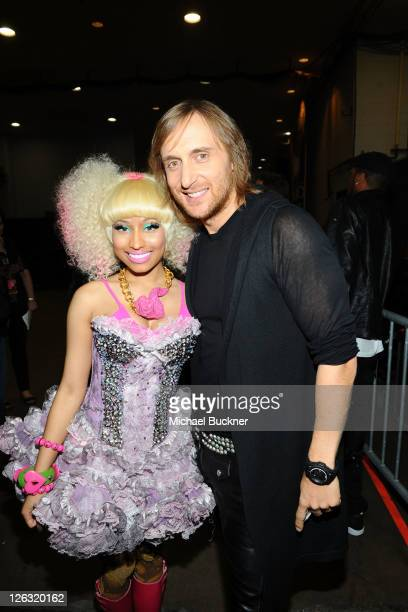 Rapper and singer Nicki Minaj and DJ David Guetta pose backstage at the iHeartRadio Music Festival held at the MGM Grand Garden Arena on September 24...