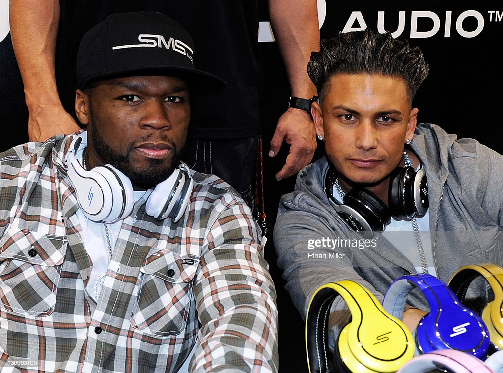 Rapper and SMS Audio CEO 50 Cent (L) and television personality DJ Paul 'Pauly D' DelVecchio pose during an autograph session at the SMS Audio booth at the 2012 International Consumer Electronics Show at the Las Vegas Convention Center January 12, 2012 in Las Vegas, Nevada. The audio company announced during CES that DelVecchio would work with 50 Cent to develop a full line of signature DJ Pauly D-branded headphones. CES, the world's largest annual consumer technology trade show, runs through January 13 and features more than 3,100 exhibitors showing off their latest products and services to about 140,000 attendees.