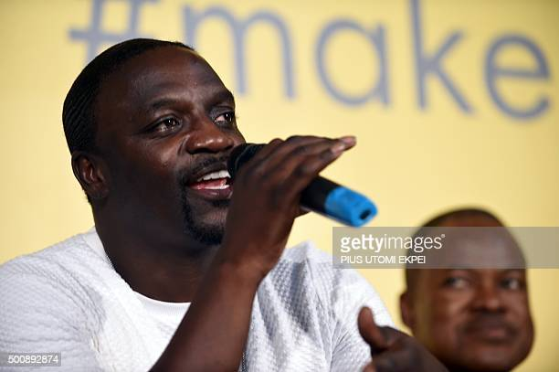 Rapper and songwriter Akon speaks during the unveiling ceremony of the Africa's first kinetic football pitch in Lagos on December 10 2015 The pitch...