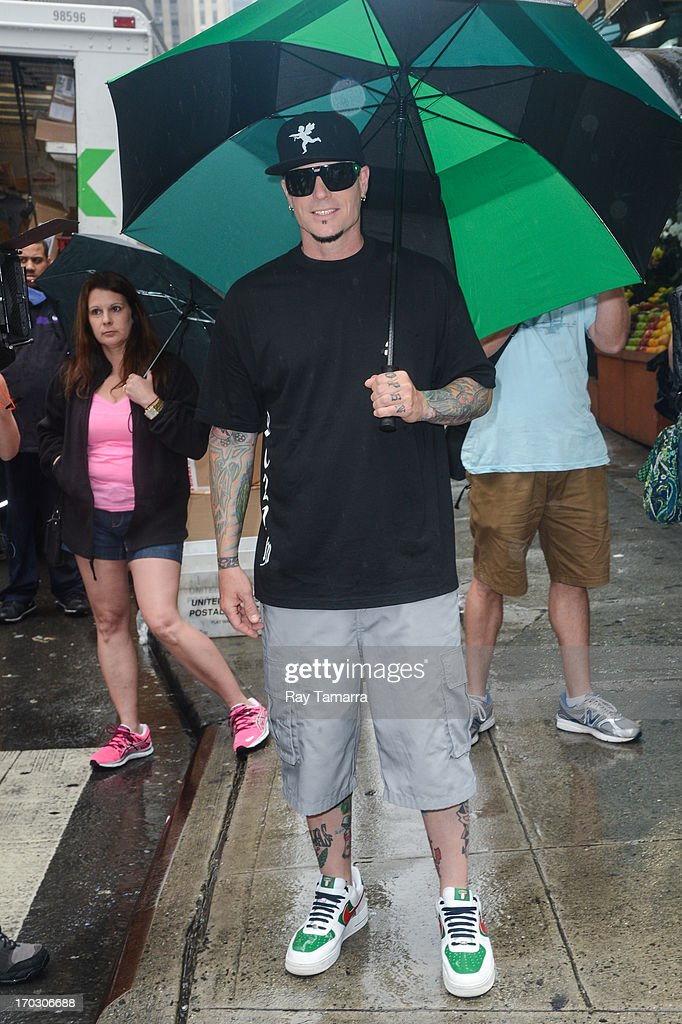 Rapper and TV personality Robert 'Vanilla Ice' Van Winkle walks in Times Square on June 10, 2013 in New York City.