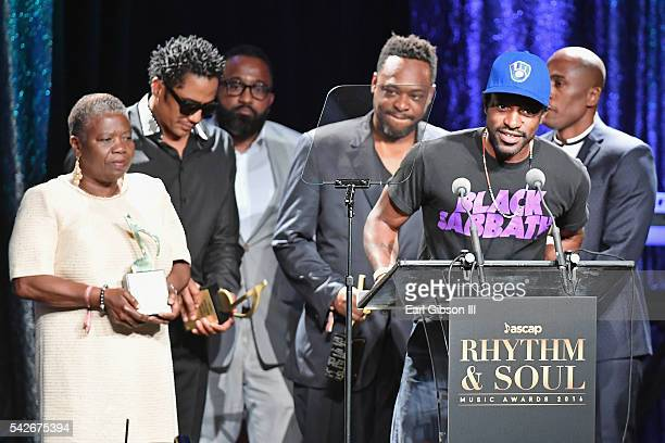 Rapper Andre 3000 speaks onstage as Cheryl BoyceTaylor mother of the late rapper Phife Dawg rappers QTip Jarobi White and Ali Shaheed Muhammad of A...