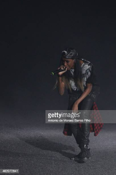 Rapper Angel Haze performs on the runway during the Philipp Plein show as a part of Milan Fashion Week Menswear Autumn/Winter 2014 on January 12 2014...