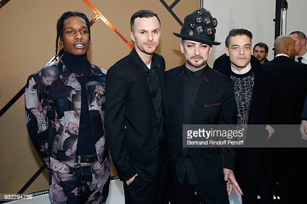 Rapper ASAP Rocky Stylist Kris Van Assche singer Boy George and actor Rami Malek pose backstage after the Dior Homme Menswear Fall/Winter 20172018...