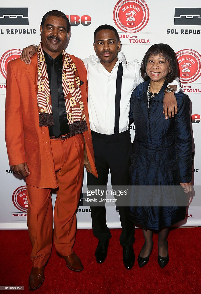 Rapper Big Sean (C) and parents attend VIBE's 20th Anniversary Celebration and Inaugural Impact Awards at the Sunset Tower Hotel on February 8, 2013 in West Hollywood, California.