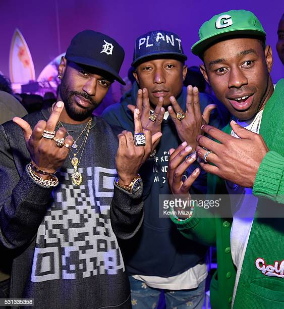 Rapper Big Sean singersongwriter Pharrell Williams and Tyler the Creator attend adidas Originals Pink Beach Pharrell Williams party on May 13 2016 in...