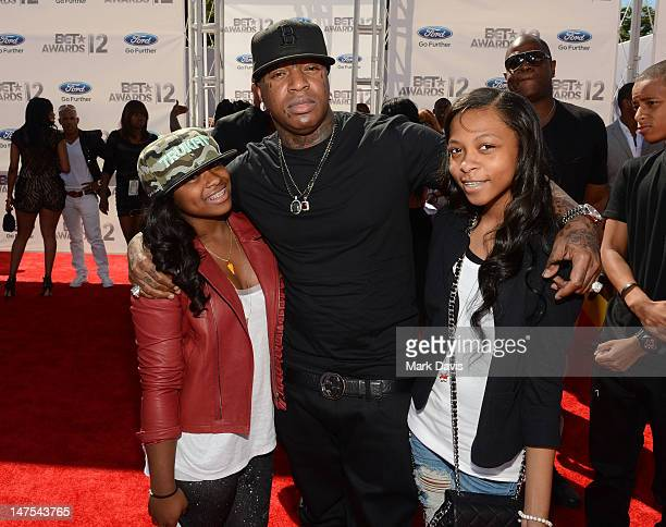 Rapper Birdman and guests arrive at the 2012 BET Awards at The Shrine Auditorium on July 1 2012 in Los Angeles California