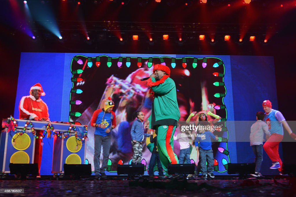 Rapper Biz Markie (L) performs at 'Yo Gabba Gabba! Live!' at The Beacon Theatre on December 21, 2013 in New York City.