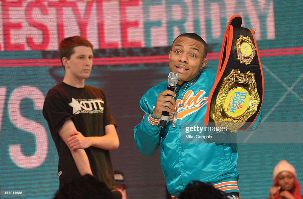 Rapper Bow Wow (C) holds up a belt after mediating a freestyle contest on BET's 106th & Park at 106 & Park Studio on March 20, 2013 in New York City.
