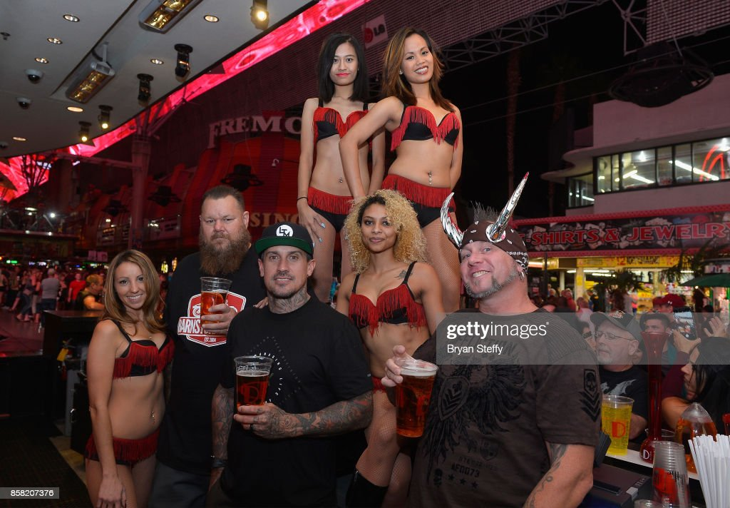 Rapper Bryan 'Big B' Mahoney, freestyle motocross rider Carey Hart and television personality 'Horny' Mike Henry pose with bar staff as they surprise guests as bartenders in support of Carey Hart's Good Ride Rally benefiting Infinite Hero Foundation at The D Bar, at the D Las Vegas on October 5, 2017 in Las Vegas, Nevada.