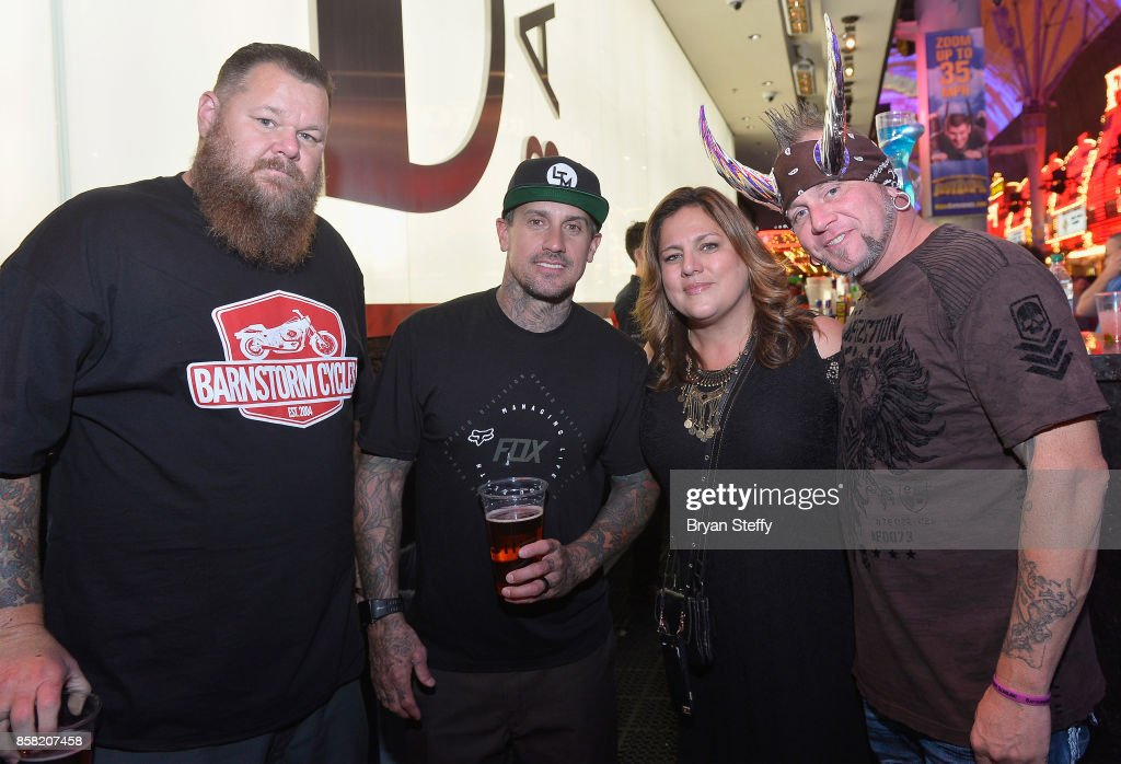 Rapper Bryan 'Big B' Mahoney, freestyle motocross rider Carey Hart, Infinite Hero Foundation Executive Director Laurie Baker and television personality 'Horny' Mike Henry attend a surprise event in support of Carey Hart's Good Ride Rally benefiting Infinite Hero Foundation at The D Bar, at the D Las Vegas on October 5, 2017 in Las Vegas, Nevada.