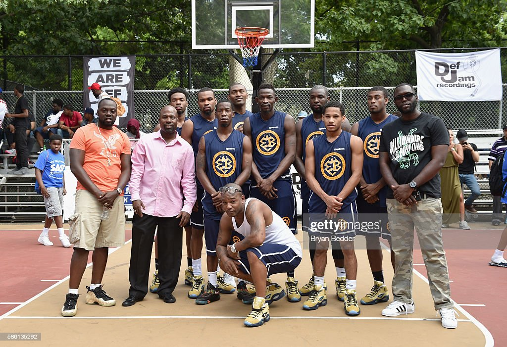 Rapper Cam'ron (C) poses with his team during the Launch of the new Reebok Question Mid EBC & A5 with Cam'ron and Jadakiss at Rucker Park on August 4, 2016 in New York City.