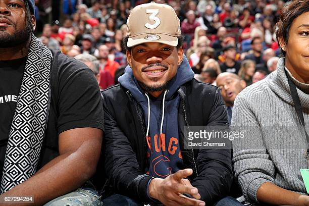 Rapper Chance the Rapper watches the game between the Chicago Bulls and the Cleveland Cavaliers on December 2 2016 at the United Center in Chicago...