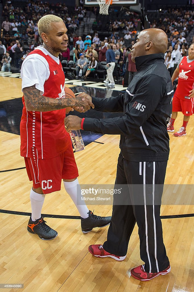 Rapper Chris Brown (L) and former professional football player Tiki Barker attend the 2014 Summer Classic Charity Basketball Game at Barclays Center on August 21, 2014 in New York City.