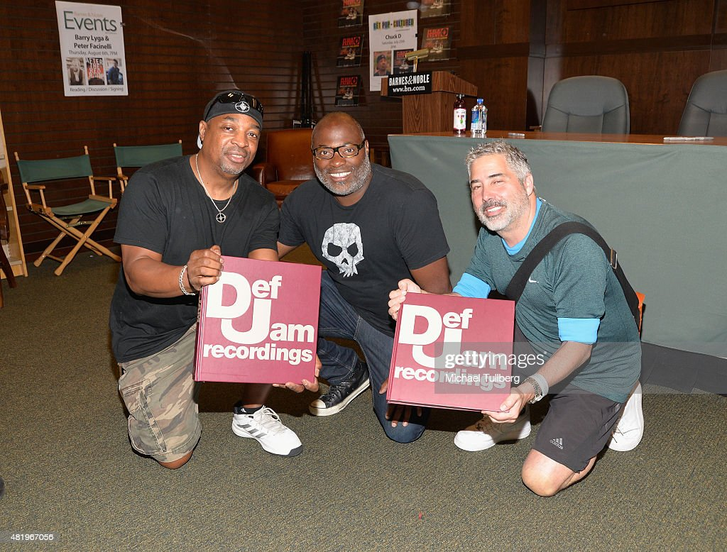 Rapper Chuck D (L) attends a signing for Public Enemy's new album 'Man Plans God Laughs' at Barnes & Noble at The Grove on July 25, 2015 in Los Angeles, California.