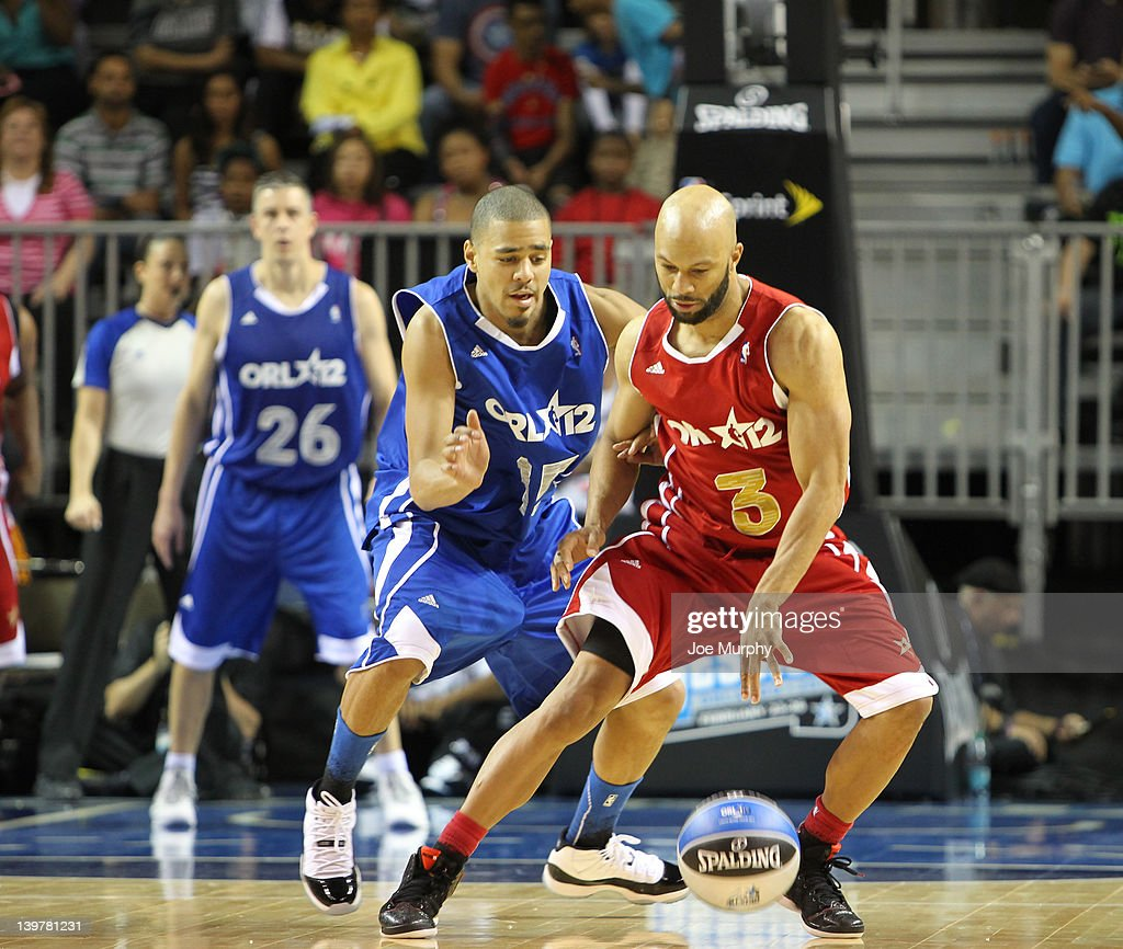 Rapper Common of the West team drives the ball against Rapper <a gi-track='captionPersonalityLinkClicked' href=/galleries/search?phrase=J.+Cole&family=editorial&specificpeople=5958978 ng-click='$event.stopPropagation()'>J. Cole</a> of the East team during the Sprint All-Star Celebrity Game on center court at Jam Session during the NBA All-Star Weekend on February 24, 2012 at the Orange County Convention Center in Orlando, Florida.