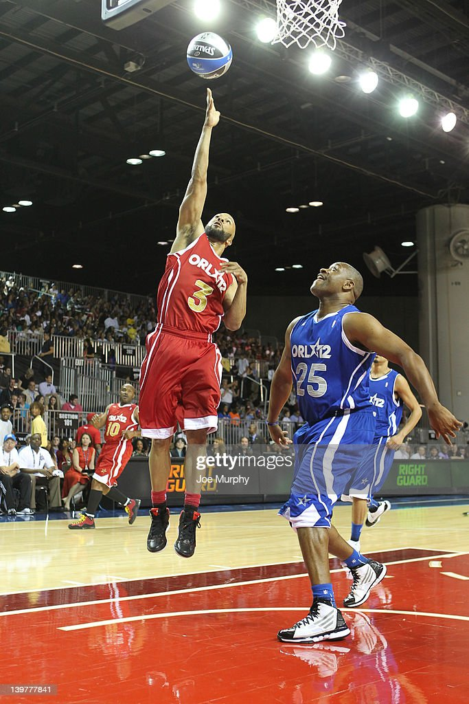 Rapper Common of the West team shoots the ball over NBA Legend Nick Anderson of the East team during the Sprint All-Star Celebrity Game on center court at Jam Session during the NBA All-Star Weekend on February 24, 2012 at the Orange County Convention Center in Orlando, Florida.