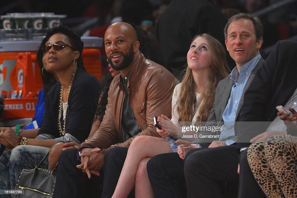 Rapper Common watches the All-Stars during 2013 NBA All-Star Game on February 17, 2013 at the Toyota Center in Houston, Texas.