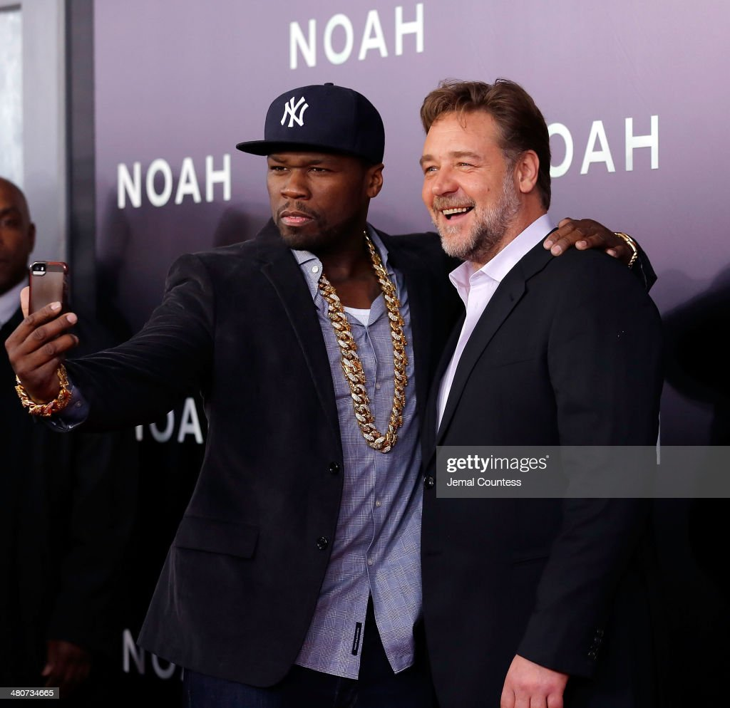 Rapper Curtis '50 Cent' Jackson and actor Russell Crowe take a 'selfie' during the New York Premiere of 'Noah' at Clearview Ziegfeld Theatre on March 26, 2014 in New York City.