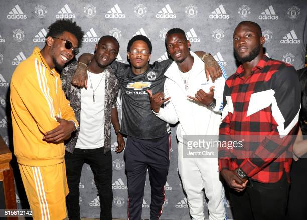 Rapper Desiigner Manchester United player Eric Bailly YG Manchester United players Paul Pogba and Romelu Lukaku attend Adidas and The Manchester...