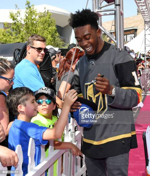 Rapper Desiigner sign autographs for fans as he attends the 2017 NHL Awards wearing a Vegas Golden Knights jersey at TMobile Arena on June 21 2017 in...