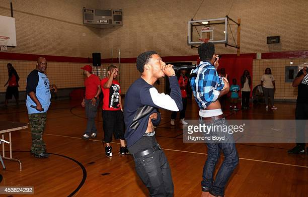 Rapper Diggy Simmons and singer and actor Trevor Jackson performs their single 'My Girl' at the Foster Park Fieldhouse on August 9 2014 in Chicago...