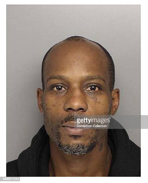 Rapper DMX poses for a mugshot at the Scottsdale City Jail after his arrest for marijuana possession and an outstanding warrant on August 21 2013 in...