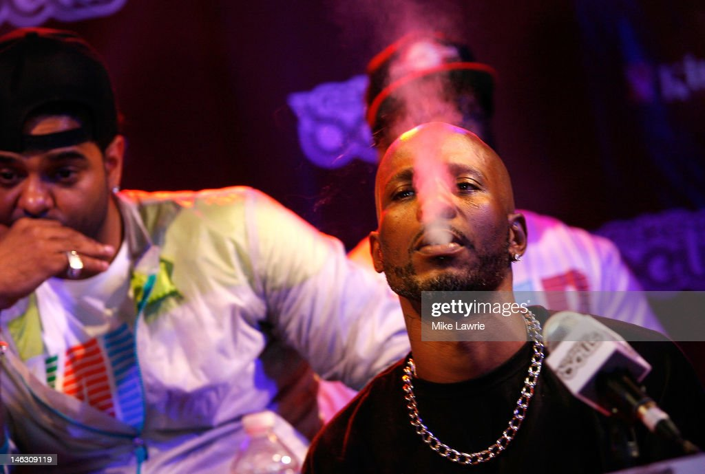 Rapper <a gi-track='captionPersonalityLinkClicked' href=/galleries/search?phrase=DMX&family=editorial&specificpeople=211365 ng-click='$event.stopPropagation()'>DMX</a> smokes a cigarette during the 2012 Rock the Bells Festival press conference and Fan Appreciation Party on at Santos Party House on June 13, 2012 in New York City.
