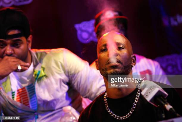 Rapper DMX smokes a cigarette during the 2012 Rock the Bells Festival press conference and Fan Appreciation Party on at Santos Party House on June 13...