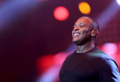 Rapper Dr Dre performs during the Snoop Dogg Kendrick Lamar JCole Miguel and SchoolBoyQ concert during the 2013 BET Experience at Staples Center on...