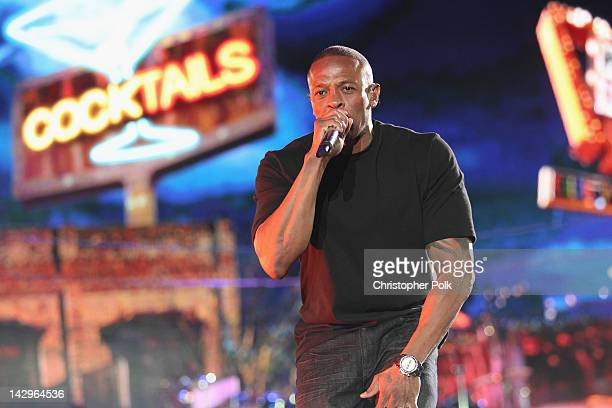 Rapper Dr Dre performs onstage during day 3 of the 2012 Coachella Valley Music Arts Festival at the Empire Polo Field on April 15 2012 in Indio...