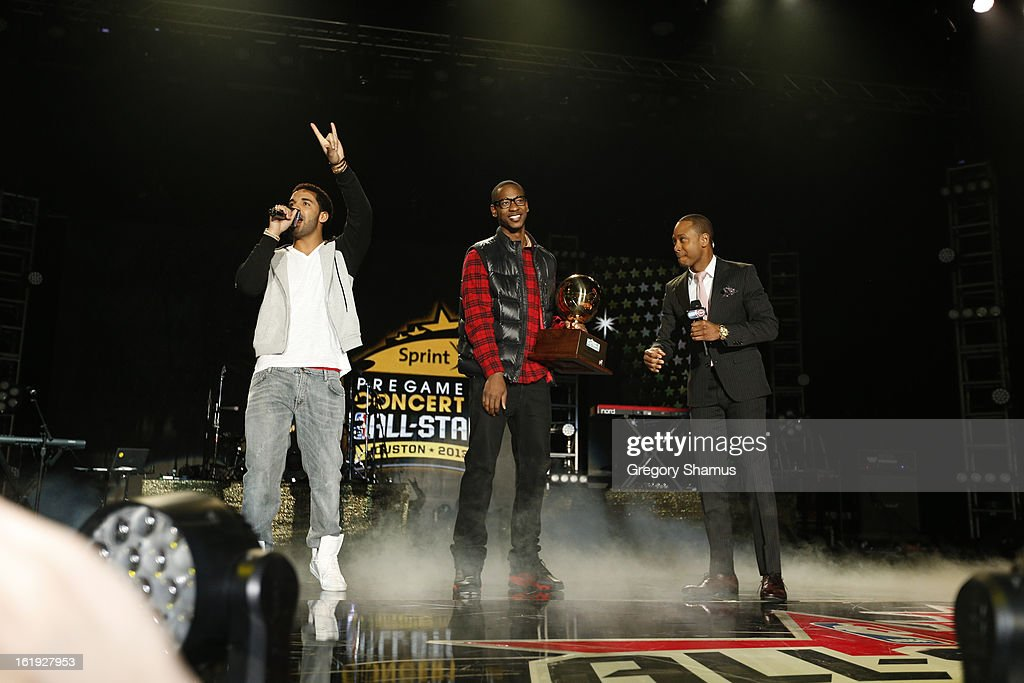 Rapper Drake and Terrence Ross #31 of the Toronto Raptors talks with Television Personality Terrence Jenkins during the Sprint NBA All-Star Pregame Concert in Sprint Arena during the NBA All-Star Weekend on February 17, 2013 at the George R. Brown Convention Center in Houston, Texas.