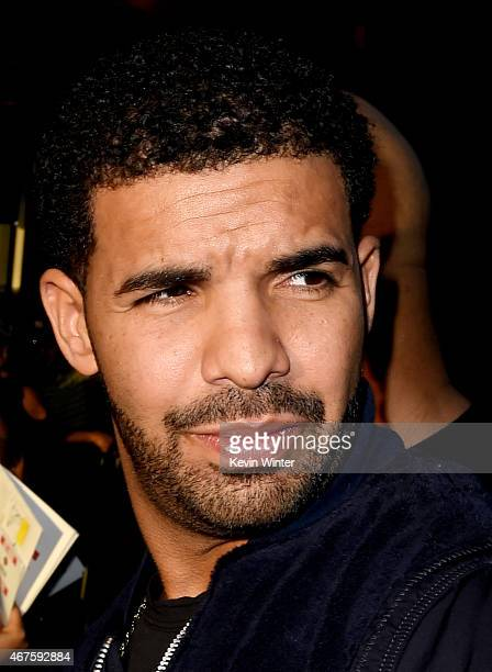 Rapper Drake arrives at the premiere of Warner Bros Pictures' 'Get Hard' at the Chinese Theatre on March 25 2015 in Los Angeles California