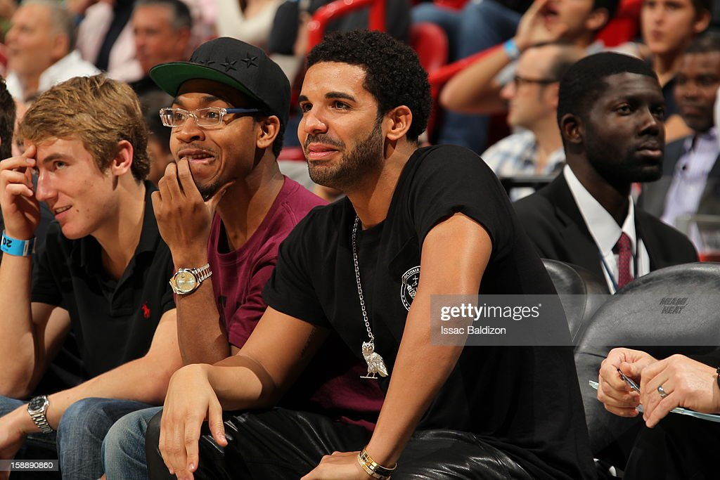 Rapper <a gi-track='captionPersonalityLinkClicked' href=/galleries/search?phrase=Drake+-+Entertainer&family=editorial&specificpeople=6927008 ng-click='$event.stopPropagation()'>Drake</a> attends the game between the Miami Heat and the Dallas Mavericks on January 2, 2013 at American Airlines Arena in Miami, Florida.