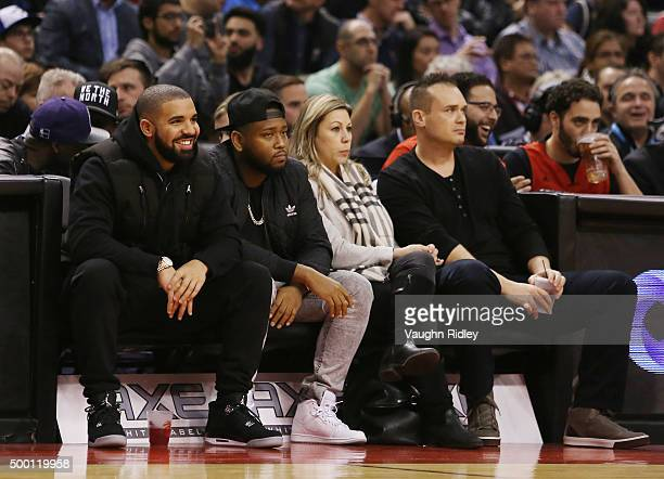 Rapper Drake looks on from his courtside seat during an NBA game between the Golden State Warriors and the Toronto Raptors at the Air Canada Centre...