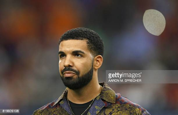 Rapper Drake looks on prior to the International Champions Cup soccer match between Manchester City against Manchester United at NRG Stadium on July...