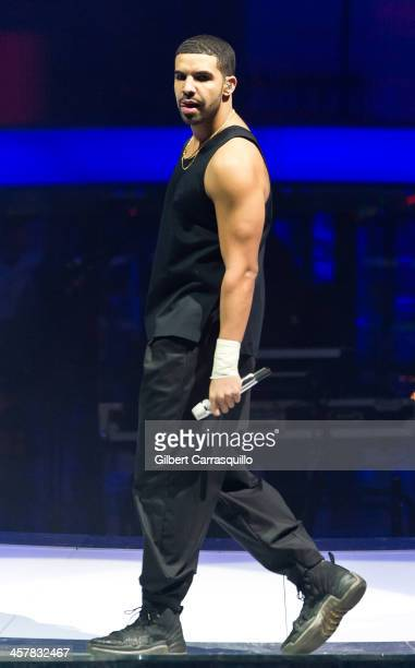 Rapper Drake performs during the 'Would You Like A Tour 2013 concert at Wells Fargo Center on December 18 2013 in Philadelphia Pennsylvania