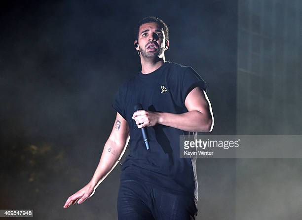 Rapper Drake performs onstage during day 3 of the 2015 Coachella Valley Music Arts Festival at the Empire Polo Club on April 12 2015 in Indio...
