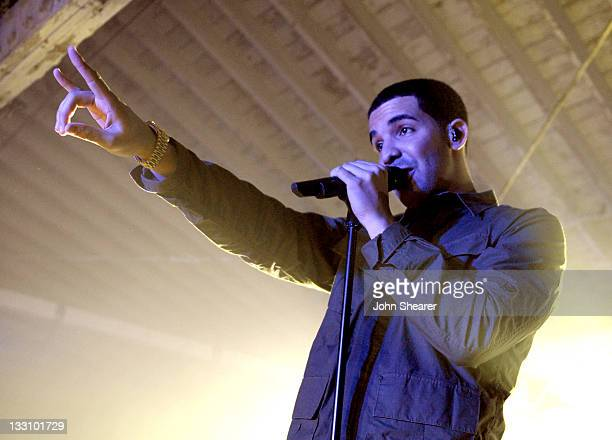 Rapper Drake performs onstage during the launch of Google Music hosted by TMobile at Mr Brainwash Studio on November 16 2011 in Los Angeles California