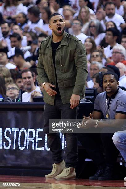 Rapper Drake reacts in the first quarter of game four of the Eastern Conference Finals between the Toronto Raptors and the Cleveland Cavaliers during...