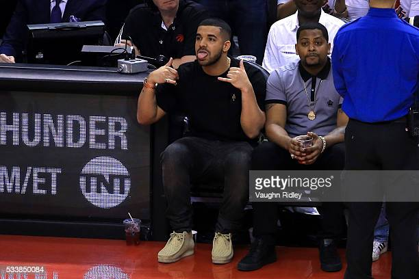 Rapper Drake reacts while sitting courtside in the first half of game four of the Eastern Conference Finals between the Cleveland Cavaliers and the...