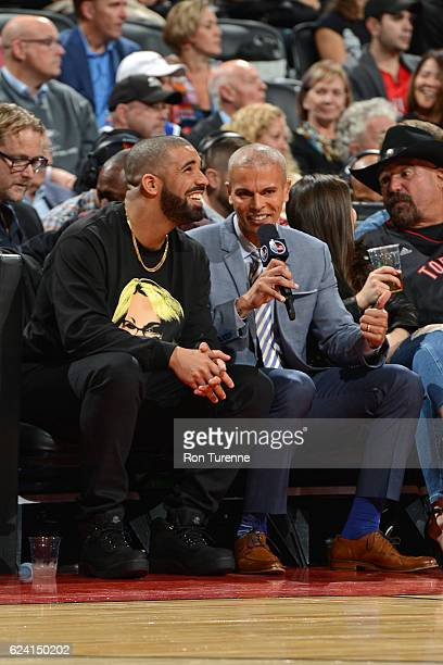 Rapper Drake speaks to NBA TNT Analyst Israel Gutierrez during the Golden State Warriors game against the Toronto Raptors on November 16 2016 at the...