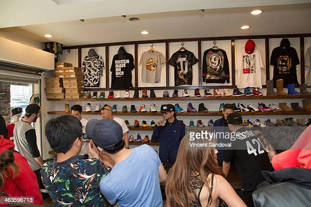 Rapper Dumbfoundead Prohgress JSplif and Kev Nish of Far East Movement attend a meet and greet at Canvas LA on January 18 2014 in Los Angeles...