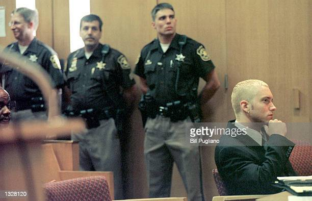Rapper Eminem watches his attorneys confer with Judge Denise Langford Morris during his sentencing hearing June 28 2001 at Oakland County Circuit...
