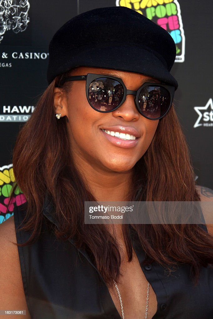 Rapper Eve attends the 10th annual Tony Hawk's Stand Up For Skateparks celebrity charity event on October 5, 2013 in Beverly Hills, California.