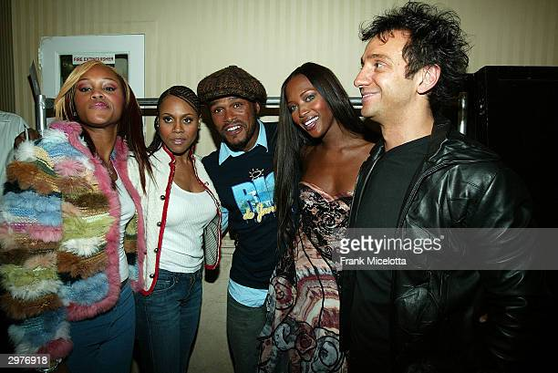 Rapper Eve singer Deborah Cox singer Maxwell model Naomi Campbell and designer Carlos Miele pose backstage at the Carlos Miele fashion show during...