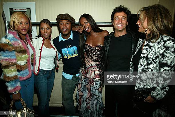 Rapper Eve singer Deborah Cox singer Maxwell model Naomi Campbell designer Carlos Miele and socialite Denise Rich pose backstage at the Carlos Miele...