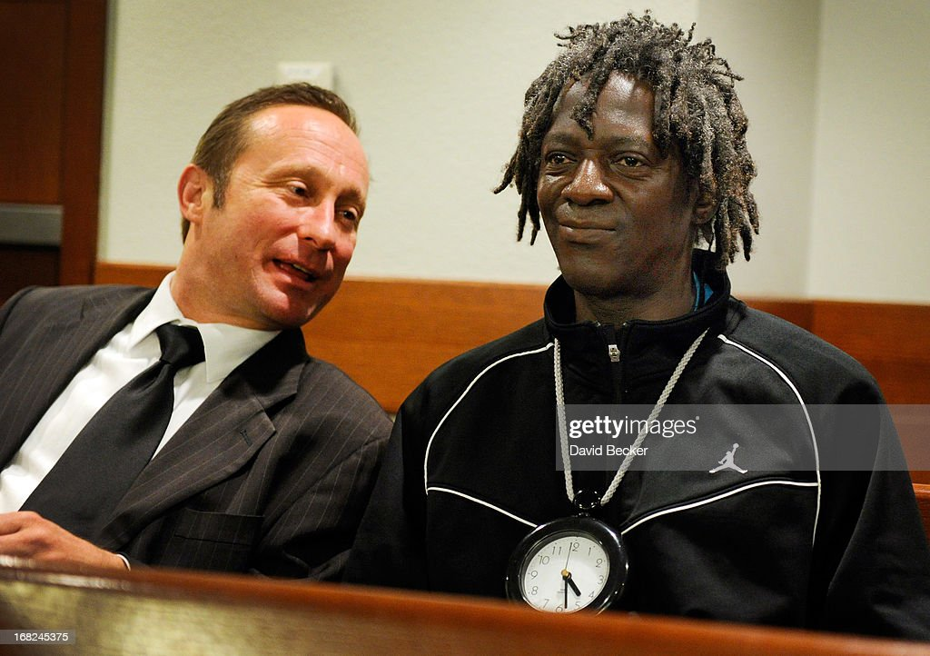 Rapper <a gi-track='captionPersonalityLinkClicked' href=/galleries/search?phrase=Flavor+Flav&family=editorial&specificpeople=171122 ng-click='$event.stopPropagation()'>Flavor Flav</a> (R) confers with his attorney Tony Abbatangelo before making an appearance at the Clark County Regional Justice Center during his arraignment on felony assault with a deadly weapon and child endangerment charges on May 7, 2013 in Las Vegas, Nevada. The entertainer, whose legal name is William Jonathan Drayton Jr., is accused of threatening his longtime girlfriend's 17-year-old son with a butcher's knife during an argument last October. Drayton is also facing a misdemeanor domestic violence battery charge.