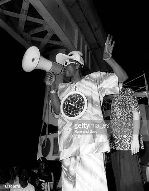 Rapper Flavor Flav of Public Enemy on the set during Public Enemy's 'Bring The Noise' video shoot with Anthrax on location in Chicago Illinois in...